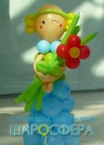 кукла из шаров с цветком